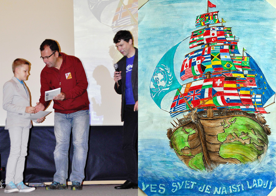"Andraž receiving the award for his 1st prize in the international round of the Barbara Petchenik competition. His winning picture ""The whole world is on the same boat"" can be seen on the right."
